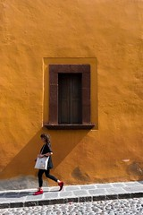 Woman walking by rustic window in San Miguel de Allende, Mexico (Gringo Photo) Tags: mexico abandoned aged antique architecture background brick building cement concrete design detail floor frame furniture grunge history home house light loft luxury material metal natural old outdoor paint room rough rustic rusty sanmigueldeallende space stone structure style texture textured traditional travel urban view vintage wall weathered white window