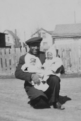 Snapshot Of A Father And His Babies (peterkelly) Tags: bw digital canon 6d toronto ontario canada northamerica rom royalontariomuseum photograph blackwhite man babies children baby hat