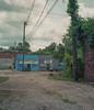 Bridge St., Yazoo City (ADMurr) Tags: ms yazoo city streetscape blue grey red rolleiflex 28 f zeiss planar 80mm crop 6x7 vertical dab047