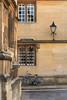 Merton Street, Oxford (Aquagg) Tags: lamp abandoned stone streetlight reflection stonework bicycle canonef50mm18ii windows mertonstreet oxford canoneos70d