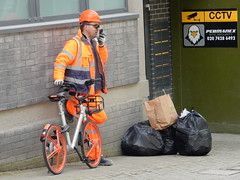 How Hi Vis do you want? (deltrems) Tags: man person bike cycle bicycle bin bags hivis helmet mobile phone cctv sign london clerkenwell farringdon