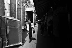 On the Light Side (elgunto) Tags: barcelona people street highcontrast blackwhite bw silhouettes shadows light sunglasses birds fujifilm fujix x100s