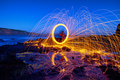 Rockpool (Pat Charles) Tags: capeschanck burn burning steelwool flame flames sparks circle twirl twirling beach reflection reflected reflections rockpool sea seaweed ocean water horizon bluehour dusk sunset evening outside outdoors outdoor circular rotate rotation flinders blairgowrie rye morningtonpeninsula redhill melbourne victoria australia travel tripod longexposure light trails nikon