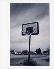 Slab City Hoop (tobysx70) Tags: instax fujifilm fuji wide monochrome bw black while instant film 500af camera roidweek roid week polaroidweek spring april 2018 slab city hoop beal road niland california ca basketball net backboard salton sea mojave desert polaroadtrip polawalk 030718 day5 toby hancock photography