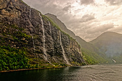 Seven Sisters (Geoff Henson) Tags: norway fjord lake river water waterfalls cliffs rocks mountains grass clouds sky rain