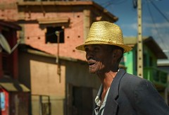 Man in the Street (Rod Waddington) Tags: africa african afrique afrika madagascar malagasy streetphotography street houses buildings hat urban man candid outdoor traditional culture cultural ethnic ethnicity