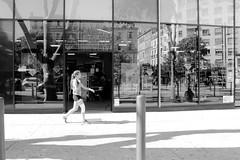 Walk on reflection (ZUHMHA) Tags: marseille france urban urbain personnes people gens human humain scènedevie monochrome vitre vitrine verre glass letter lettre mot word sign texte text écriture reflet reflection line lignes courbes curve geometry géométrie