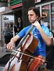 Cellist (sea turtle) Tags: seattle universitydistrict udistrict street fair streetfair festival streetfestival spring sunny sunshine city urban outdoors musician streetmusician cello cellist