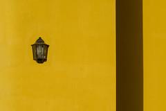 Lamp on a yellow wall (Jan van der Wolf) Tags: map182266ve yellow geel gevel gebouw facade lamp light shadow schaduw monochrome monochroom fuerteventura minimal minimalism simpel simple geometry