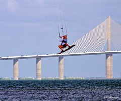 Kite Boarder Rides the Skyway (pandt) Tags: kiteboard ftdesoto fort desoto park pinellas county florida sunshinestate sunshineskywaysky clouds water ocean coast sea tampabay bridge jump kite board canon eos slr 7d outdoor landscape flickr sky