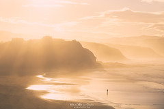Alone in the beach (Mimadeo) Tags: beach person man lonely one alone solitude walking coast shoreline sea ocean sunset basquecountry basque sopelana sopela evening cliff cliffs paisvasco euskadi monochrome waves healthy lifestyle golden landscape beautiful haze hazy mist fog foggy misty walk copyspace