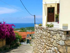 a lane in Kyparissia IMG_8074 (mygreecetravelblog) Tags: greece peloponnese messenia messinia kyparissia town outdoor landscape architecture buildings walls lane alley road street bougainvillea house stonewall