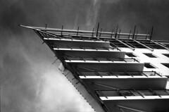Princes Wharf  -  (Film) (Harald Philipp) Tags: princeswharf auckland cbd newzealand blackandwhite bw film ilford delta400 hotel apartments water pier nikonf6 nikon nikkor building city urban skyline grain 35mm modernarchitecture
