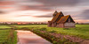 St Thomas a Becket Church sunset (Nathan J Hammonds) Tags: thomas becket church romney marsh kent uk sunset clouds hdr long exposure nd filter 10stop nikon d750 movement drifting reflection water grass colour buidings landscape