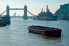 River Thames (Geoff Henson) Tags: thames bridge towerbridge warship navy hmsbelfast ship boat barge buildings guns mast river water sky