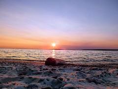 Sunset Beach (michaeldantesalazar) Tags: beach sunset sunsets nature log lake sun sky landscape rocks sand water reflection clouds soft lakewinnipeg hecla island beautiful colours color