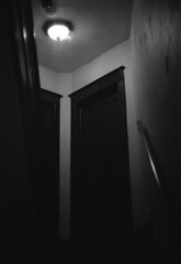 in-7 (kaumpphoto) Tags: mamiya nc1000s bw black white door light wall stairs stairwell texture ceiling railing wood architecture interior 7 seven frame smokealarm alarm safety glass electricity electric lamp shine entrance corner dark