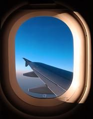 I get the window seat! (SCFiasco) Tags: sunset sun window topv111 plane flying dusk saveme3 deleteme10 framed horizon flight wing frame porthole scfiasco topphotoblog siasoco edwinsiasoco edsiasoco