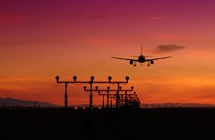 Summer Landing (Erich J. Harvey) Tags: hello sunset vancouver airport kiss britishcolumbia ground 2006 landing welcome yvr vancouverairport aug20 2feet erichharvey utatafeature auguest20