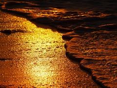 Liquid gold sand (underflow) Tags: sunset sea italy sun texture sol beach nature water colors wow gold reflex fantastic agua tramonto playa poker straight liquid dorada 3ofakind top20reflections top20colorpix allthatglittersisgold 250v10f 2pair
