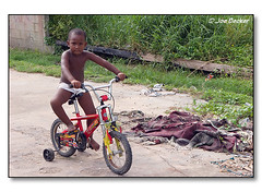Young Belizean Boy on Bicycle (#06001283) (jbecker_99) Tags: boy playing bicycle child play belize belizecity youngster playful centralamerica becker latinamerican centralamerican