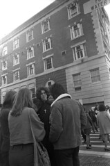 110570 02 (ndpa / s. lundeen, archivist) Tags: street city november cambridge people blackandwhite bw woman man building men film monochrome boston 35mm cross candid massachusetts harvard citylife streetphotography christian harvardsquare pedestrians cape cloak frock priest 1970 mass 1970s crosswalk youngman apartmentbuilding youngpeople dewolf crossingthestreet dunsterstreet nickdewolf photographbynickdewolf