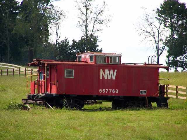A red caboose in somebody's yard
