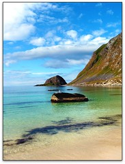 Cool waters of Norway (jurek d.) Tags: blue sky mountains beach norway clouds coast bravo pi creativecommons scandinavia lofoten waterscape lofots jurekd