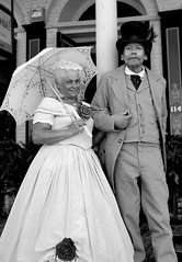 Dressed For The Occasion (Keith Lovelady's Photography) Tags: costumes portrait people blackandwhite bw building hat umbrella buildings blackwhite dress minolta hats husbandandwife oldbuildings dresses parasol tophat maxxum7d 7d konica sacramento bandw twopeople oldbuilding km oldsac maxxum bwphoto sacramentoca oldwestern oldwest oldtownsacramento konicaminolta blackwhitephoto blackandwhitephoto outforastroll bwphotos blackandwhitephotos olddress olddresses blackandwhitephotograph elderlycouple sacramentocalifornia bwphotographs km7d bwphotograph blackwhitephotograph blackwhitephotos blackandwhitephotographs konicaminoltamaxxum7d oldtownsac blackwhitephotographs bandwphoto goldrushday sacramentocaliforniagoldrushday oldsacramentocaliforniagoldrushday sacramentocagoldrushday oldsacramentocagoldrushday oldtownsacramentocagoldrushday oldtownsacramentocaliforniagoldrushday kmm7d kmmaxxum7d bandwphotograph bandwphotos