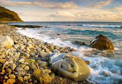 Sunset over Jurassic coast (Nigel Danson) Tags: sea england coast boulders dorset jurassic nikonstunninggallery