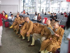 a row of chinese monks at the ferry terminal (kafka4prez) Tags: island shanghai farm visit organic chongming   rootsshoots