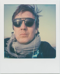 Watching the sunset (SX-70) (mmartinsson) Tags: impossiblefilm sx70 color sunset reflection instantfilm colour selfie analoguephotography whiteframe impossibleproject scan epsonperfectionv700 polaroid 2018 sunglasses watching kalmar kalmarlän sverige se