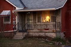 A Window, Two Cats, and a Lamp (Haytham M.) Tags: canada ontario afternoon dusk roof cats cat window house lamp street