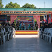 Multinational service members and honored guests celebrate the groundbreaking ceremony at Cabu Elementary School in support of Exercise Balikatan