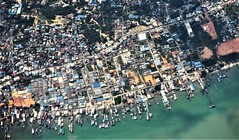 somewhere over Indonesia (SM Tham) Tags: asia southeastasia indonesia island fishing harbour pier jetty townscape landscape aerialview buildings sea water land trees boats streets roads