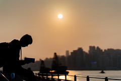 Soaking the sunshine (bady_qb) Tags: sunshine sony sonyalpha sonya7ii a7ii hongkong hongkon cultural central 85mm silhouette people