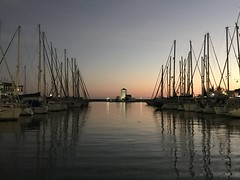 Sunset at Almeria at the harbour (vickyouten) Tags: church lighthouse beach spain almeria yachts ships boats harbour sunset
