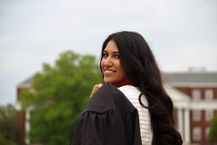 Bismah (manalbukhari) Tags: grad graduate graduation graduating maryland red gown girl beautiful smile water close far pretty long hair green grass trees focus depth