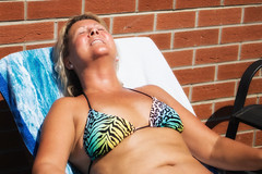 Topping up the tan (Mary&Neil) Tags: elements mary sunbathing woman bikini tan blonde