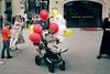 evil look (reenoreluv) Tags: amusementpark balloons kids witch streetphotography happy sad