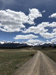 San Juan Range. (Chuckcars) Tags: fourteeners sanjuan pines top road sky clouds panoramic pano mountains colorado
