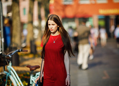 (graveur8x) Tags: woman candid street portrait red dress streetphotography girl beautiful dof people look eyecontact hair sun light hot spring contrast colours bag city female neckless mainz germany deutschland strase europe frau canon canoneos5dmarkiv canonef135mmf2lusm f2 135mm 5d