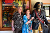 Mom and Dad and The Captain (Poocher7) Tags: portrait people captainhook shoppes shoppesofrosehall jamaica westindies caribbean bluemountaincoffee jamaicanflag souvenirs coupler mom dad fun smiles seniors happycouple pirate pistols knife eyepatch pirateofthecaribbean