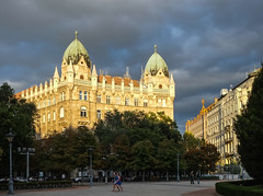 Budapest @ dusk (Marian Pollock) Tags: hungary budapest dusk architecture building street girls shadows dome clouds sunset sunshine trees square szabadsagter