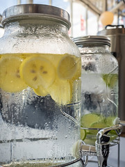 Ice cold water freshened with slices of orange in a glass dispenser (Victor Wong (sfe-co2)) Tags: background beverage catering chill citrus clean closeup cocktail cold concept condensation container cool cooler dispenser drink droplet equipment faucet fresh fruit glass healthy homemade ice jar jug lemon lemonade liquid mason metal natural orange party refreshment rustic sign signboard stainless steel summer sweet table tap tropical water wet white yellow
