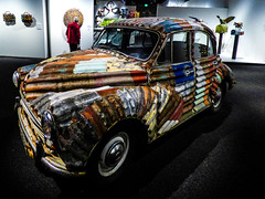 No Roof Rack Needed (Steve Taylor (Photography)) Tags: canterburymuseum christchurch jeffthomson corrugationstheartofjeffthomson corrugated iron bag letterbox car cow pheasant bird art design sculpture colourful museum metal woman lady newzealand nz southisland canterbury