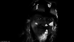 Scoundrel In The Shadows. (Neil. Moralee) Tags: neilmoralee piratebrixhamneilmoralee dark shadow scoundrel sinister criminal lightroom effects black white bw bandw blackandwhite pirate brixham 2018 neil moralee nikon d7200 highlights fun face portrait people man mature eyes hat underexposed noir