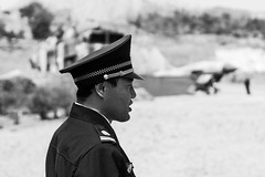 Surveillance (Go-tea 郭天) Tags: qingdao huangdao cangmashan moutain guard security safety officer control surveillance uniform man work working job duty alone lonely portrait cap fighter jet mockup sun sunny shadow hot day street urban city outside outdoor people candid bw bnw black white blackwhite blackandwhite monochrome naturallight natural light asia asian china chinese shandong canon eos 100d 24mm prime