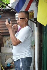 yep, still got that lucky whisker (the foreign photographer - ฝรั่งถ่) Tags: man looking mirror pulling whisker flags standing khlong bang bua portraits bangkhen bangkok thailand nikon d3200