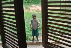47a6da22b3127cce98549808438e00000030108AcNmbZu3csx-1 (partnerschoolsworldwide) Tags: africa ghana boy student small toddler child chalkboard learning education outside classroom window holding alphabet cute